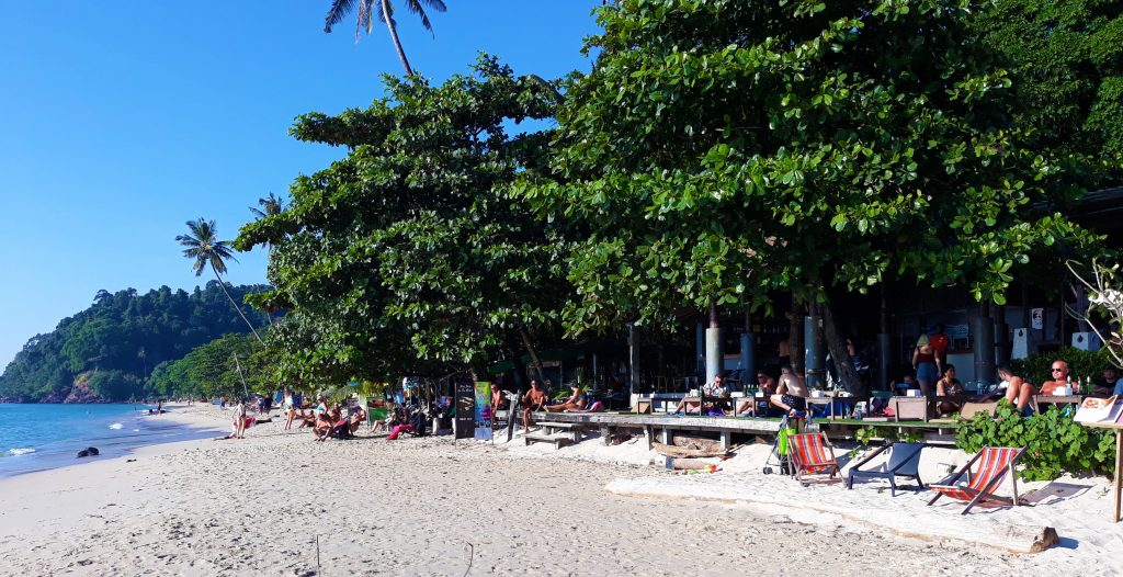 People Dining at Restaurant on Beach