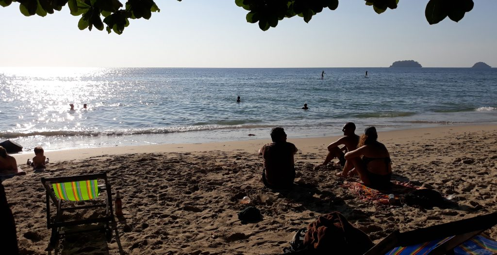 People Sitting on Sand at Beach